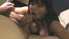 Kinky Asian MILF masturbates and sucks a white cock Thumb