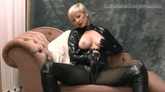 Blonde rubs leather gloves against tits and wet pussy Thumb