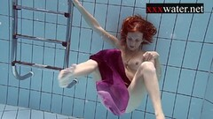 Smoking hot redhead naked in the pool Thumb