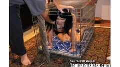 Petite babe stuffed in a cage and fed cock Thumb