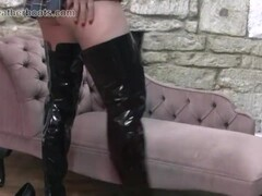 Sexy schoolgirl Simone wears her mothers slutty leather boots when at home alone Thumb