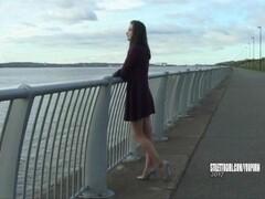 Leggy brunette Keri teases her long legs silver high heels for your shoe fetish Thumb
