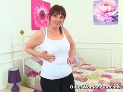 British milf Beau Diamonds lowers her leggings and plays Thumb