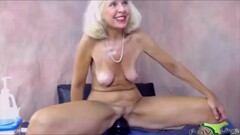 Skilful mature woman bangs her old pussy with a huge toy Thumb
